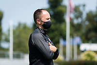 CARY, NC - SEPTEMBER 12: Portland Thorns head coach Mark Parsons takes a look at the pitch before a game between Portland Thorns FC and North Carolina Courage at WakeMed Soccer Park on September 12, 2021 in Cary, North Carolina.