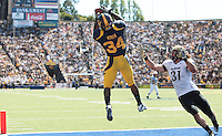 Shane Vereen catches the touchdown pass above Jon Major. The California Golden Bears defeated the Colorado Buffaloes 52-7 at Memorial Stadium in Berkeley, California on September 11th, 2010.