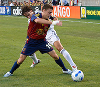 Real Salt Lake defender Kevin Novak battles with Real Madrid Captain Raul in the Real Madrid 2-0 win over Real Salt Lake at Rice Eccles Stadium in Salt Lake City, Utah August 12, 2006.