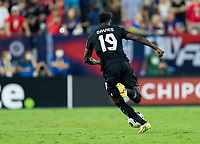 NASHVILLE, TN - SEPTEMBER 5: Alphonso Davies #19 of Canada dribbles during a game between Canada and USMNT at Nissan Stadium on September 5, 2021 in Nashville, Tennessee.