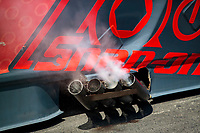 Aug 8, 2020; Clermont, Indiana, USA; Detailed view of exhaust from the header pipes on the engine of the NHRA funny car driven by Cruz Pedregon during qualifying for the Indy Nationals at Lucas Oil Raceway. Mandatory Credit: Mark J. Rebilas-USA TODAY Sports
