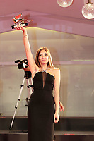 """VENICE, ITALY - SEPTEMBER 11: Director Audrey Diwan poses with the Golden Lion for """"L'Evenement"""" at the awards winner photocall during the 78th Venice International Film Festival on September 11, 2021 in Venice, Italy."""