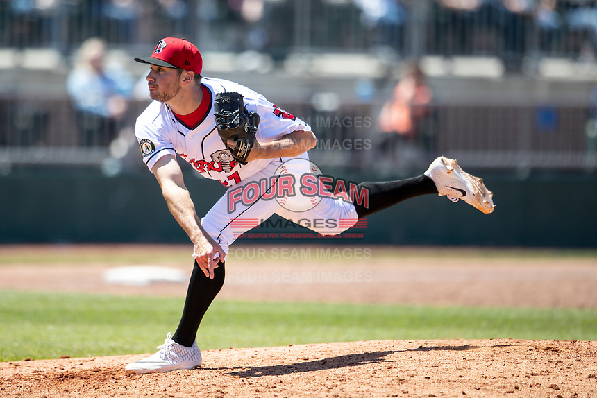 Lansing Lugnuts pitcher Brandon Withers (27) delivers a pitch to the plate on May 30, 2021 against the Great Lakes Loons at Jackson Field in Lansing, Michigan. (Andrew Woolley/Four Seam Images)