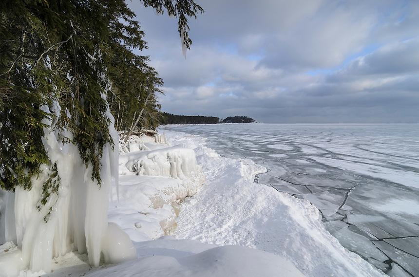 A beautiful morning view of the frozen Lake Superior shoreline near Little Presque Isle. Marquette, MI