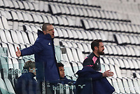 Calcio, Serie A: Juventus FC - S.S.Lazio, Turin, Allianz Stadium, March 6, 2021.<br /> Juventus' Leonardio Bonucci (l) and Carlo Pinzoglio (r) speaks to the players from the bench during the Italian Serie A football match between Juventus and Lazio at the Allianz stadium in Turin, on March 6, 2021.<br /> UPDATE IMAGES PRESS/Isabella Bonotto