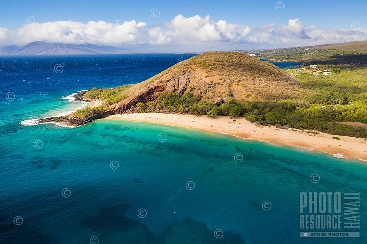A clear day at Makena Beach, Maui, seen from above, with West Maui Mountains in background.
