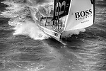 Aerial photo-shoot of the IMOCA Open 60 Alex Thomson Racing Hugo Boss during a training session before the VendÈe Globe in the English Channel..The VendÈe Globe is a round-the-world single-handed yacht race, sailed non-stop and without assistance.