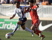 Charlie Davies battles Zhang Yaokun for the ball. The USA defeated China, 4-1, in an international friendly at Spartan Stadium, San Jose, CA on June 2, 2007.