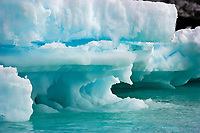 wave-sculpted iceberg in Shingle Cove, Coronation Island, Antarctica, Southern Ocean