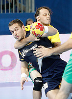 Spain's Victor Tomas Gonzalez (l) and Australia's Mitchell Hedges during 23rd Men's Handball World Championship preliminary round match.January 15,2013. (ALTERPHOTOS/Acero) /NortePhoto