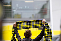 16th May 2020, Signal Iduna Park, Dortmund, Germany; Bundesliga football, Borussia Dortmund versus FC Schalke;  Outdoor shot before the first matchday of the Ghost Games because of the coronavirus, In picture Dortmund fan with scarf holds it aloft