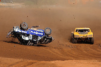 Apr 17, 2010; Surprise, AZ USA; LOORRS pro 4 unlimited driver Josh Merrell flips his truck as Jerry Daugherty passes on the inside during round 3 at Speedworld Off Road Park. Mandatory Credit: Mark J. Rebilas-US PRESSWIRE.