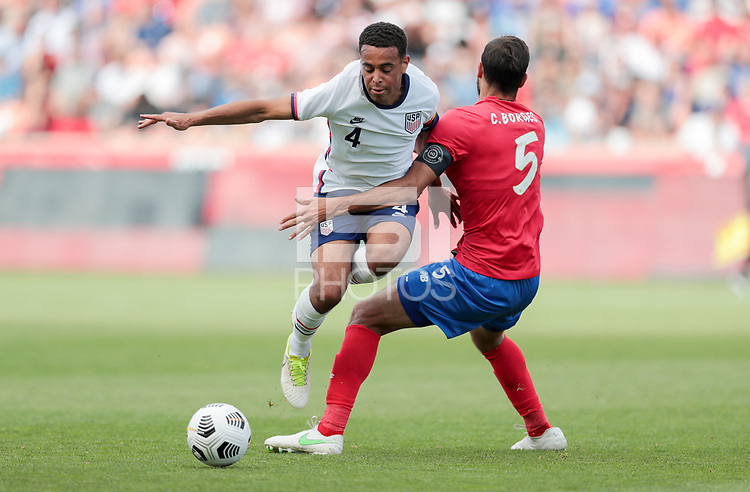 SANDY, UT - JUNE 10: Tyler Adams #4 of the United States chases down a loose ball during a game between Costa Rica and USMNT at Rio Tinto Stadium on June 10, 2021 in Sandy, Utah.