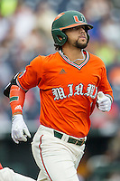 Miami Hurricanes outfielder Carl Chester (9) runs to first base against the UC Santa Barbara Gauchos in Game 5 of the NCAA College World Series on June 20, 2016 at TD Ameritrade Park in Omaha, Nebraska. UC Santa Barbara defeated Miami  5-3. (Andrew Woolley/Four Seam Images)
