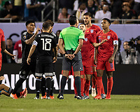 CHICAGO, IL - JULY 7: Players from both teams argue with the referee during a game between Mexico and USMNT at Soldiers Field on July 7, 2019 in Chicago, Illinois.