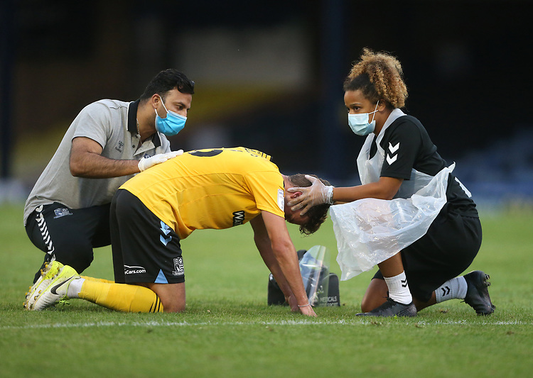 Southend United's Harry Phillips receives treatment for an injury<br /> <br /> Photographer Rob Newell/CameraSport<br /> <br /> EFL Trophy Southern Section Group A - Southend United v West Ham United U21 - Tuesday 8th September 2020 - Roots Hall - Southend-on-Sea<br />  <br /> World Copyright © 2020 CameraSport. All rights reserved. 43 Linden Ave. Countesthorpe. Leicester. England. LE8 5PG - Tel: +44 (0) 116 277 4147 - admin@camerasport.com - www.camerasport.com
