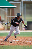 GCL Marlins center fielder Rosandel Reyna (1) follows through on a swing during a game against the GCL Astros on July 22, 2017 at Roger Dean Stadium Complex in Jupiter, Florida.  GCL Astros defeated the GCL Marlins 5-1, the game was called in the seventh inning due to rain.  (Mike Janes/Four Seam Images)