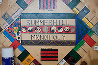 The Summerhill Monopoly board, Summerhill School, Leiston, Suffolk. The school was founded by A.S.Neill in 1921 and is run on democratic lines with each person, adult or child, having an equal say.  You don't have to go to lessons if you don't want to but could play all day.  It gets above average GCSE exam results.