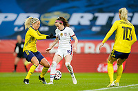 SOLNA, SWEDEN - APRIL 10: Rose Lavelle #16 of the United States turns and moves with the ball during a game between Sweden and USWNT at Friends Arena on April 10, 2021 in Solna, Sweden.