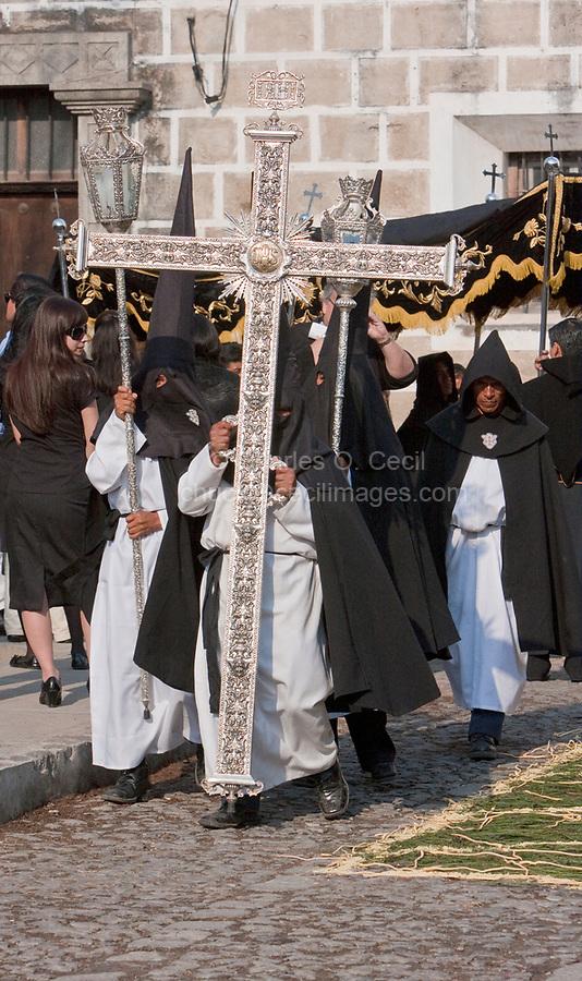 Antigua, Guatemala.  Holy Saturday.  Nazarenos Marching in the Procession of the Virgin of Solitude (Virgen de Soledad), Holy Week, La Semana Santa.