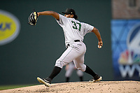 Starting pitcher Norwith Gudino (26) of the Augusta GreenJackets delivers a pitch in a game against the Greenville Drive on Thursday, August 29, 2019, at Fluor Field at the West End in Greenville, South Carolina. Augusta won, 11-0. (Tom Priddy/Four Seam Images)