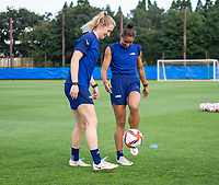 KASHIMA, JAPAN - AUGUST 1: Samantha Mewis #3 and Lynn Williams #21 of the USWNT warm up before  a training session at the practice field on August 1, 2021 in Kashima, Japan.