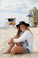 Tayla, 22, of Banksia Grove had a shock diagnosis of a melanoma. Now she's cautious about the sun. Pictured at Cottesloe Beach. photo by Trevor Collens