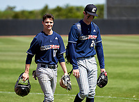 Calvary Christian Academy Eagles catcher Nick Cafaro (17) and pitcher Andrew Painter (24) walk to the dugout before a game against the IMG Academy Ascenders on March 13, 2021 at IMG Academy in Bradenton, Florida.  (Mike Janes/Four Seam Images)