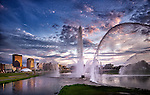 Wide view of Dayton OH skyline with fountains. Evening