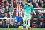 Lionel Andres Messi (r) of FC Barcelona fights for the ball with Filipe Luis of Atletico de Madrid during their La Liga match between Atletico de Madrid and FC Barcelona at the Santiago Bernabeu Stadium on 26 February 2017 in Madrid, Spain. Photo by Diego Gonzalez Souto / Power Sport Images