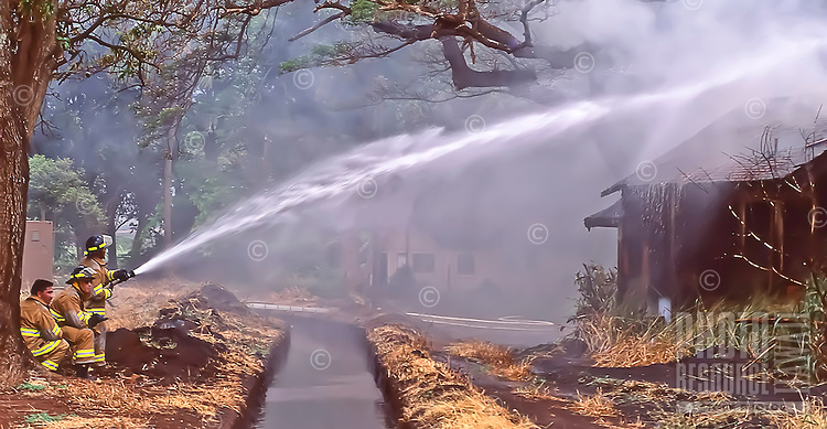 One of the last aged/condemed cane houses in the old Pu'unene sugar camp is used for fire fighting training by the Maui County Fire Department, Maui, circa 1992.