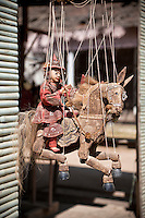 Myanmar, Burma.  Mingun, near Mandalay.  Marionette Horseback Rider for Sale in a Shop.