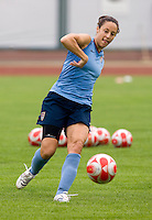 USWNT defender Kate Markgraf passes the ball forward during practice at Beijing Normal University in preparation for the Olympic gold medal game at Workers' Stadium in Beijing, China.