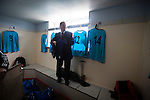 Harestanes AFC v Girvan FC, 15/08/2015. Scottish Cup preliminary round, Duncansfield Park. A club official putting out the home team's kit in the dressing room before Harestanes AFC take on Girvan FC in a Scottish Cup preliminary round tie, staged at Duncansfield Park, home of Kilsyth Rangers. The home team were the first winners of the Scottish Amateur Cup to be admitted directly into the Scottish Cup in the modern era, whilst the visitors participated as a result of being members of both the Scottish Football Association and the Scottish Junior Football Association. Girvan won the match by 3-0, watched by a crowd of 300, which was moved from Harestanes ground as it did not comply with Scottish Cup standards. Photo by Colin McPherson.