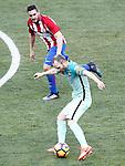 Atletico de Madrid's Koke Resurrecccion (t) and FC Barcelona's Andres Iniesta during La Liga match. February 26,2017. (ALTERPHOTOS/Acero)