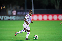 LAKE BUENA VISTA, FL - AUGUST 06: Sebastian Mendez #8 of Orlando City SC dribbles the ball during a game between Orlando City SC and Minnesota United FC at ESPN Wide World of Sports on August 06, 2020 in Lake Buena Vista, Florida.