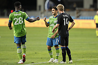 SAN JOSE, CA - OCTOBER 18: Yeimar Gomez Andrade #28 of the Seattle Sounders fist bumps teammate Cristian Roldan #7 during a game between Seattle Sounders FC and San Jose Earthquakes at Earthquakes Stadium on October 18, 2020 in San Jose, California.