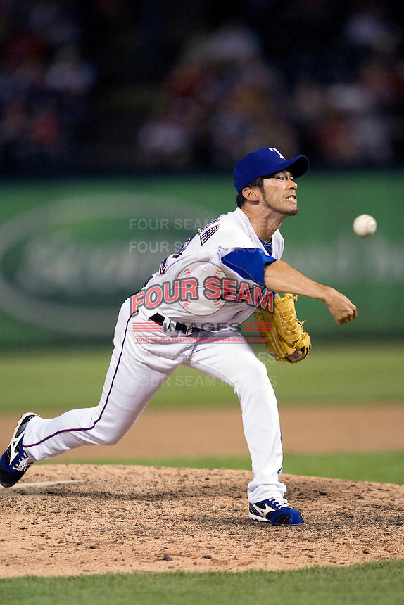 Texas Rangers pitcher Yoshinori Tateyama #22 delivers a pitch during the Major League Baseball game against the Texas Rangers at the Rangers Ballpark in Arlington, Texas on July 27, 2011. Minnesota defeated Texas 7-2.  (Andrew Woolley/Four Seam Images)