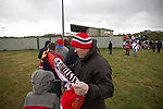 Hednesford Town 2 FC United 1, 11/05/2013. Key's Park, Northern Premier League. A man wrapping a scarf around a boy outside Key's Park prior to the Hednesford Town versus FC United of Manchester Northern Premier League premier division play-off final. The match would decide which club were promoted to the Blue Square Conference North. Hednesford won the game by 2 goals to 1 in front of a stadium record attendance of 4412 spectators. Photo by Colin McPherson.