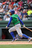 Shortstop Raul Adalberto Mondesi (2) of the Lexington Legends bats in a game against the Greenville Drive on Friday, August 18, 2013, at Fluor Field at the West End in Greenville, South Carolina. Mondesi is the No. 5 prospect of the Kansas City Royals. Lexington won, 5-0. (Tom Priddy/Four Seam Images)