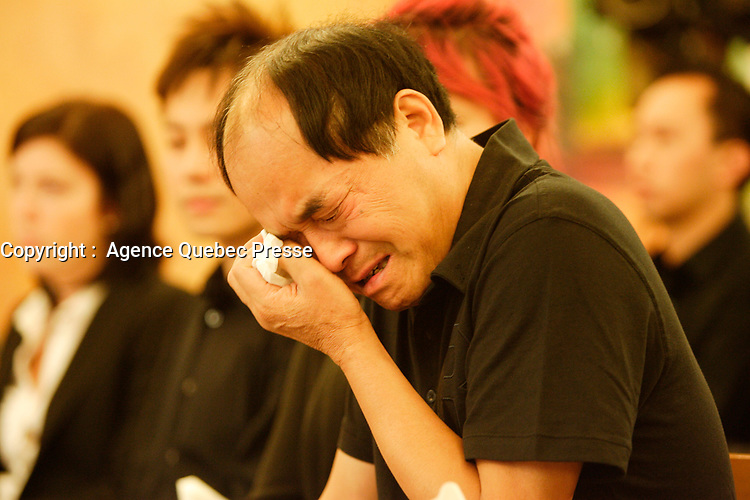 FILE PHOTO  - Public funeral of Jun Lin, the Concordia student allegedly killed and dismembered by Luka Rocco Magnotta.,<br />  The funerals attended by his family were held July 26, 2012<br /> <br /> PHOTO :  Agence Quebec Presse