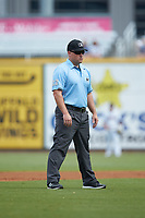 Third base umpire William Posey works the Southern League game between the Pensacola Blue Wahoos and the Birmingham Barons at Regions Field on July 7, 2019 in Birmingham, Alabama. The Barons defeated the Blue Wahoos 6-5 in 10 innings. (Brian Westerholt/Four Seam Images)