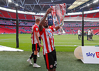 29th May 2021; Wembley Stadium, London, England; English Football League Championship Football, Playoff Final, Brentford FC versus Swansea City; Tariqe Fosu of Brentford celebrates with the Sky Bet EFL Championship Plays-off Trophy and their 2-0 win and promotion to the Premier League