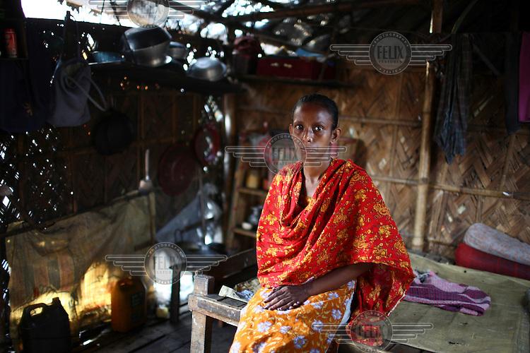 Selina, a garment worker in her home in Rayerbazar slum, in Dhaka..