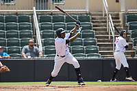 Micker Adolfo (27) of the Kannapolis Intimidators follows through on his swing against the West Virginia Power at Kannapolis Intimidators Stadium on June 18, 2017 in Kannapolis, North Carolina.  The Intimidators defeated the Power 5-3 to win the South Atlantic League Northern Division first half title.  It is the first trip to the playoffs for the Intimidators since 2009.  (Brian Westerholt/Four Seam Images)