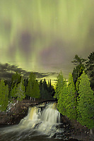 """""""Aurora over Gooseberry Falls""""<br /> Each tier of the falls along the Gooseberry River is beautiful and unique. When the Upper Falls are crowned with the brilliant aurora borealis, the scene is even more stunning. The roar of the falls drowns out any sound beyond five feet of the observer. It is surreal to witness this spectacular phenomenon pulsing overhead in the vast starry skies."""