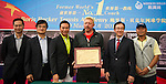 L-R: Joseph Wang, Ke Guangming, Mission Hills Vice Chairman Tenniel Chu, tennis legend Boris Becker with his handprint, Hong Kong tennis association President Philip Mok, and Zhao Zhiqiang pose for a photograph during the press conference for the opening of Boris Becker Tennis Academy at Mission Hills Resort on 19 March 2016, in Shenzhen, China. Photo by Lucas Schifres / Power Sport Images