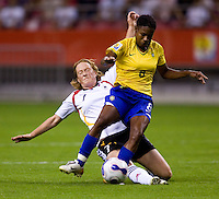 Germany midfielder (7) Melanie Behringer tackles Brazil forward (8) Formiga. Germany defeated Brazil, 2-0 during the FIFA Women's World Cup final at Hongkou Stadium in Shanghai, China on September 30, 2007.