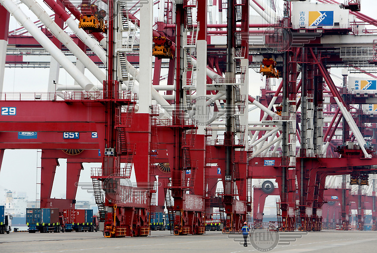 Cargo cranes operate on the docks of Qingdao Port.
