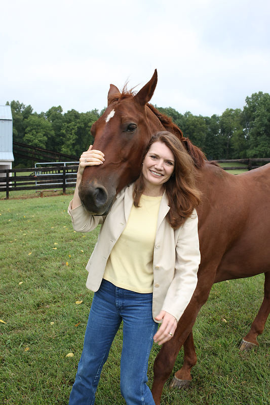 """{September 18, 2009} {11am} -- Culpeper, VA. -- Author Jeannette Walls poses with her horse Jackson at her farm in Culpeper, VA. Walls has written a book called """"Half-Broke Horses: A True Life Novel."""" The book is about her grandmother who was a wild west woman who broke horses.. -- ...Photo by Andrew B. Shurtleff, Freelance."""